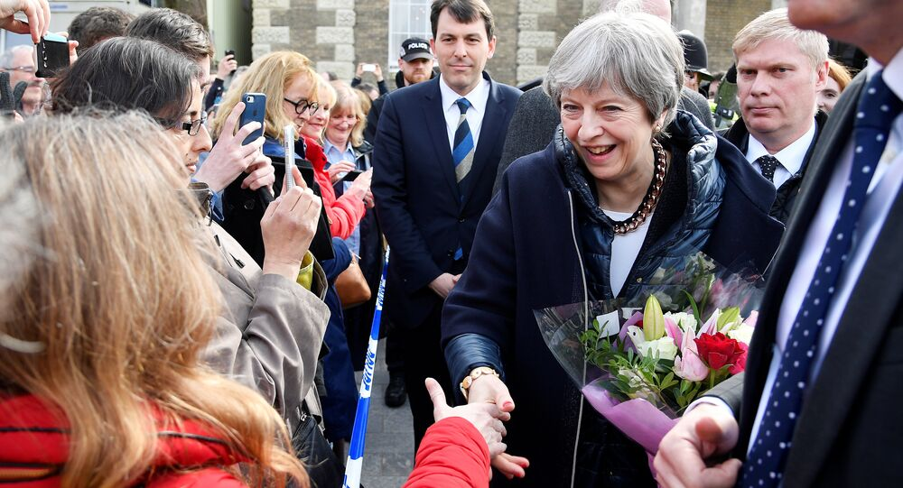 Britain's Prime Minister Theresa May greets people after visiting the scene where former Russian intelligence officer Sergei Skripal and his daughter Yulia were found after they were poisoned with a nerve agent, in Salisbury, Britain March 15, 2018