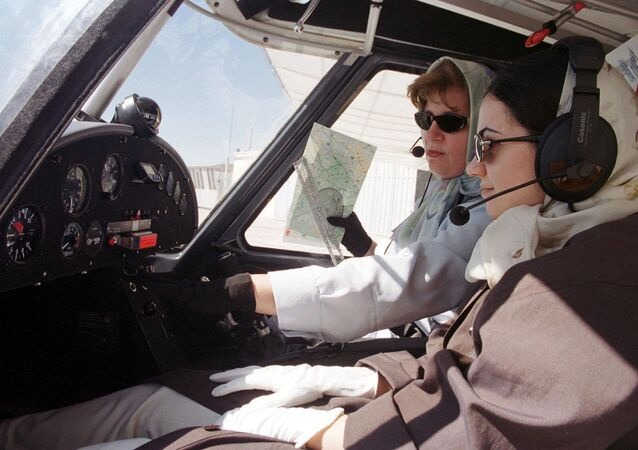 Iranian co-pilot and instructor Nahid Qafarian carries out a pre-flight test 01 June 2001 in the cabin of a German-made Ikarus C-42 light plane, together with her student Maryam Azaran (R), who is one of only three women taking flying lessons at a private flying club outside the Iranian city of Qazvin, some 100 kms west of Tehran
