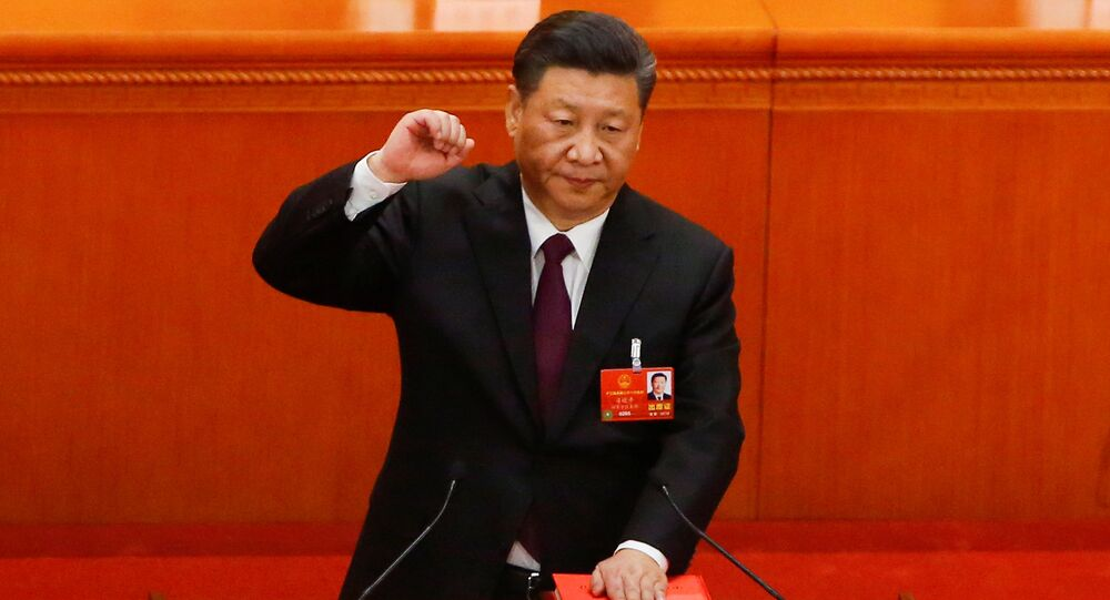 Chinese President Xi Jinping pledges an oath to the Constitution after being confirmed president for another term during the fifth plenary session of the National People's Congress (NPC) at the Great Hall of the People in Beijing, China March 17, 2018
