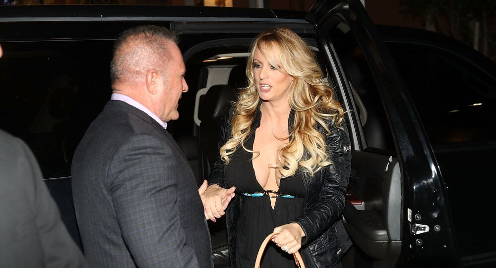 In this file photo taken on March 10, 2018 The actress Stephanie Clifford, who uses the stage name Stormy Daniels, arrives to perform at the Solid Gold Fort Lauderdale strip club in Pompano Beach, Florida
