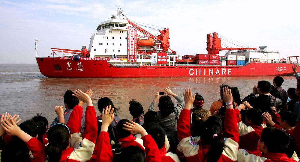 In this photo released by China's official Xinhua news agency, well-wishers wave to the Chinese exploration ship Xue Long at the Waigaoqiao Dock in Shanghai, east China, on Monday November 12, 2007