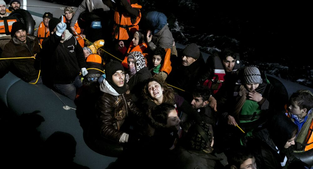 (File) Refugees and migrants aboard an inflatable dinghy are about to be rescued by MOAS (Migrant Offshore Aid Station) while attempting to reach the Greek island of Agathonisi, Dodecanese, southeastern Agean Sea, overnight on January 16, 2016