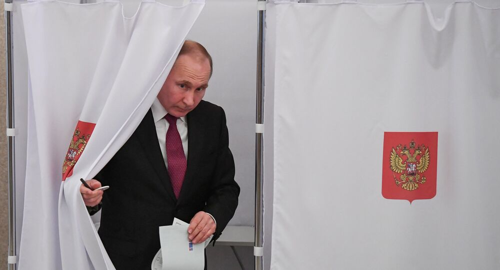 Russian President and Presidential candidate Vladimir Putin at a polling station during the presidential election in Moscow, Russia March 18, 2018