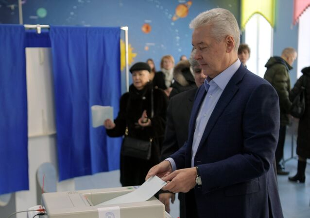 Moscow Mayor Sergei Sobyanin during the voting at the Russian presidential elections at polling station No. 90 in Moscow
