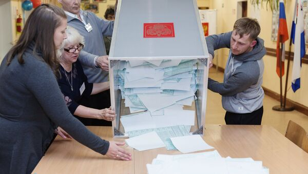 Votes counted at Russian presidential elections - Sputnik International