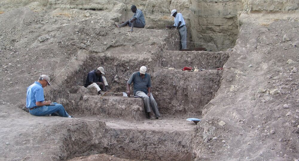 Smithsonian researchers are seen at the Olorgesailie Basin excavation site where red ocher pigments were found with Middle Stone Age artifacts, in southern Kenya in this undated handout photograph released on March 15, 2018