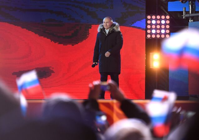 Russian President Vladimir Putin attends the concert and meeting celebrating the first anniversary of Crimea's reunification with Russia, at Manezhnaya Square in Moscow