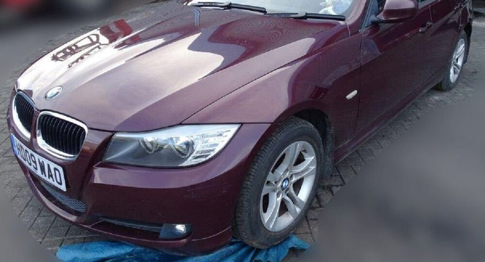 A burgundy red BMW car owned by former Russian spy Sergei Skripal is seen in this photograph released by the Metropolitan Police in London, Britain March 17, 2018