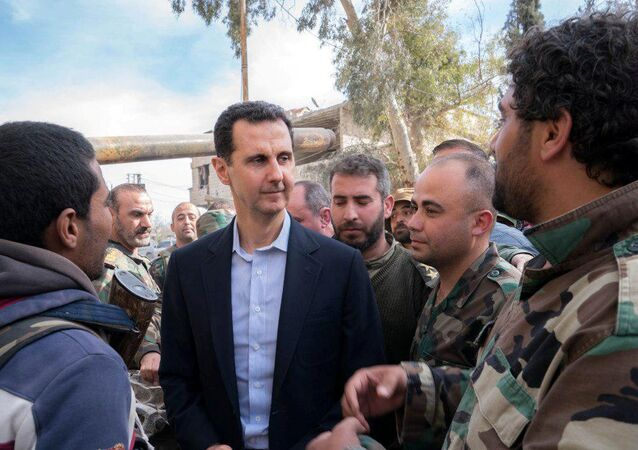 Syrian President Bashar al-Assad meets with Syrian army soldiers in eastern Ghouta, Syria, March 18, 2018