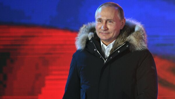 Russian President Vladimir Putin attends the concert and meeting celebrating the first anniversary of Crimea's reunification with Russia, at Manezhnaya Square in Moscow - Sputnik International