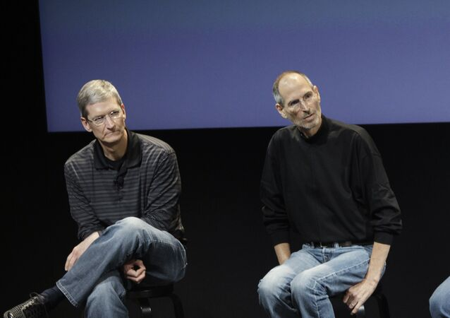 In this July 16, 2010 photo shows Apple's Tim Cook, left, and Steve Jobs, right, during a meeting at Apple in Cupertino, Calif.