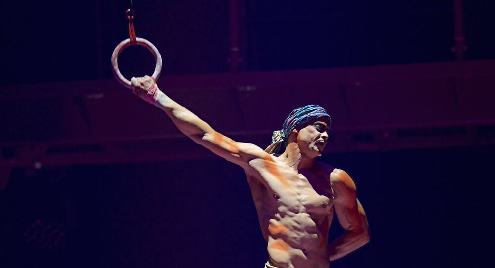 This Sept. 24, 2017, photo provided by Michael Kass shows Yann Arnaud during a Cirque du Soleil performance in Toronto