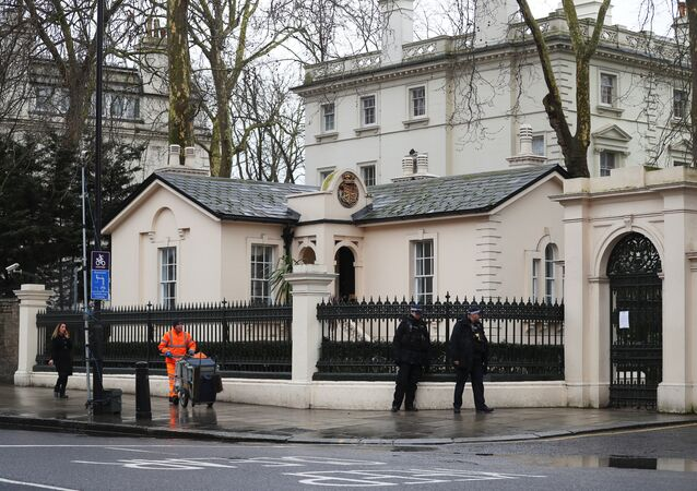 Police officers walk past the consular section of Russia's embassy in London, Britain, March 15, 2018