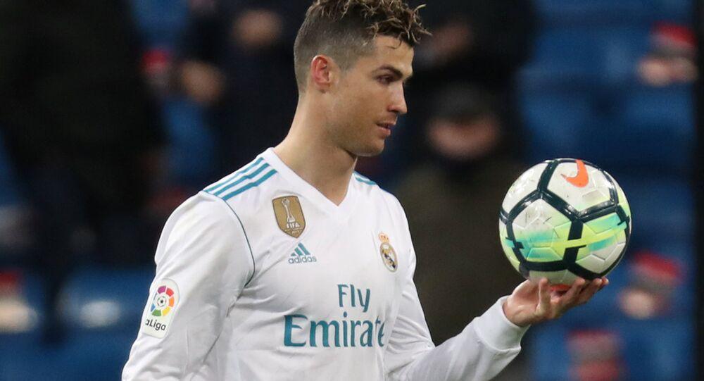 Soccer Football - La Liga Santander - Real Madrid vs Girona - Santiago Bernabeu, Madrid, Spain - March 18, 2018 Real Madrid's Cristiano Ronaldo with the matchball after the match