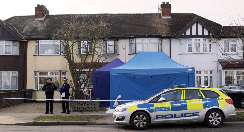 Police stand outside a house in New Malden, southwest London, Wednesday March 14, 2018, which has been sealed-off after Russian businessman Nikolai Glushkov has been found dead