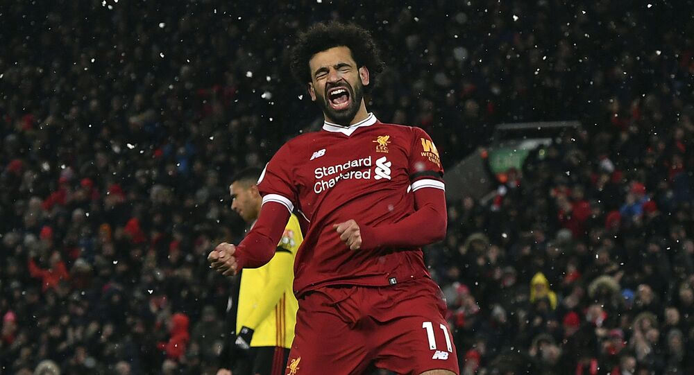 Liverpool's Mohamed Salah celebrates scoring his hat-trick during the English Premier League soccer match between Liverpool and Watford at Anfield, Liverpool, England