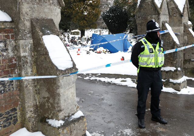 A police officer stands outside the London Road cemetery where the grave of Alexander Skripal; son of former Russian intelligence officer Sergei Skripal; is seen covered with a tent, in Salisbury, Britain