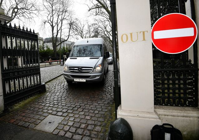 A bus carrying embassy staff and children leave Russia's Embassy in London, Britain, March 20, 2018