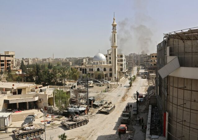 Syrian pro government forces enter the main square of Kfar Batna, Southeastern Ghouta, on the eastern outskirts of the capital Damascus, on March 19, 2018