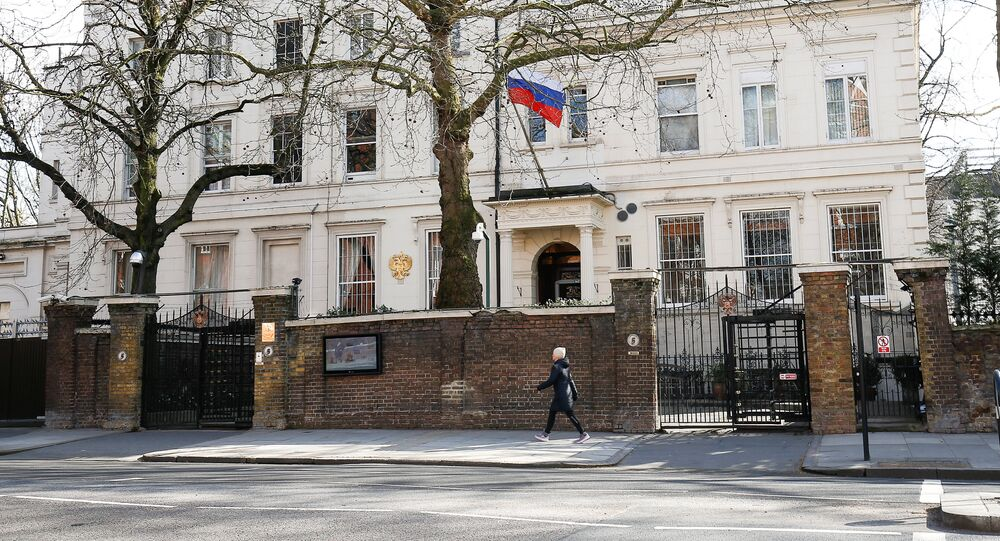 A woman walks past the Russian Embassy in London, Britain, March 19, 2018