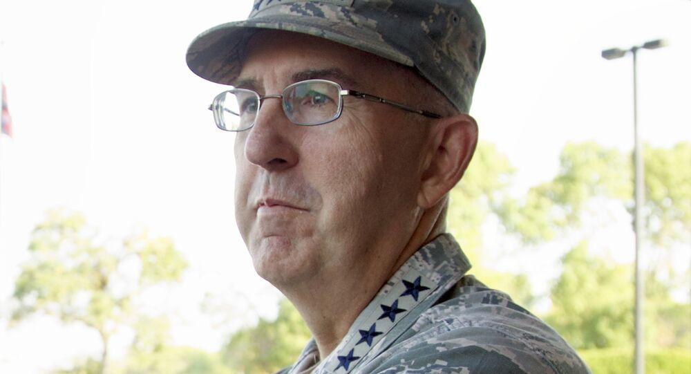 Gen. John E. Hyten, the head of Strategic Command at Offutt Air Force Base in Bellevue, Neb., waits Thursday, Sept. 14, 2017, to greet Secretary of Defense Jim Mattis