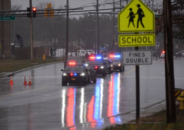 Law enforcement motorcade is seen near the Great Mills High School following a shooting on Tuesday morning in St. Mary's County, Maryland, U.S., March 20, 2018