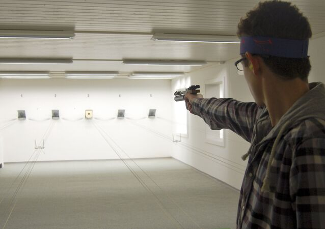 A man trains with a softair pistole on the shooting range of the village's shooting club in Bueren an der Aare near Bern, Switzerland. (File)