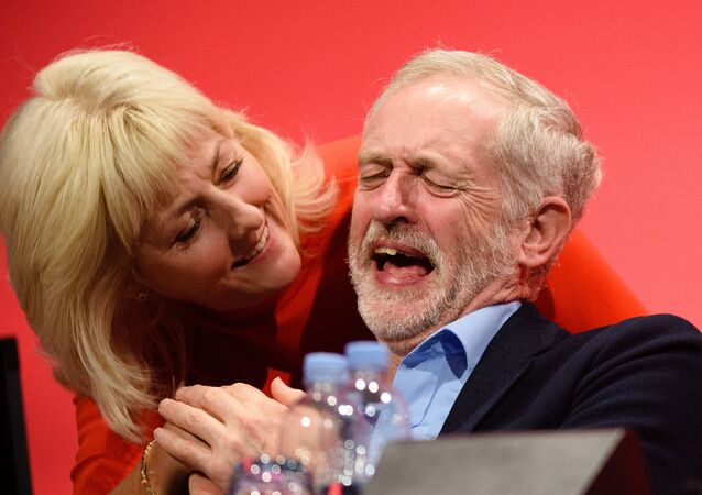 Opposition Labour Party leader Jeremy Corbyn shares a joke with Jennie Formby on day two of the annual Labour party conference in Brighton. (File)