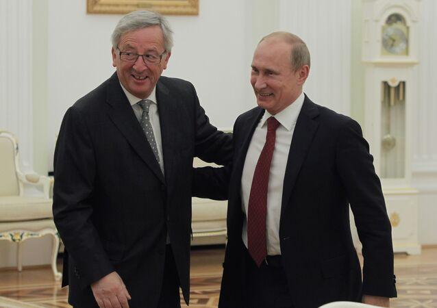 Russian President Vladimir Putin, right, and European Commission President Jean-Claude Juncker. File photo
