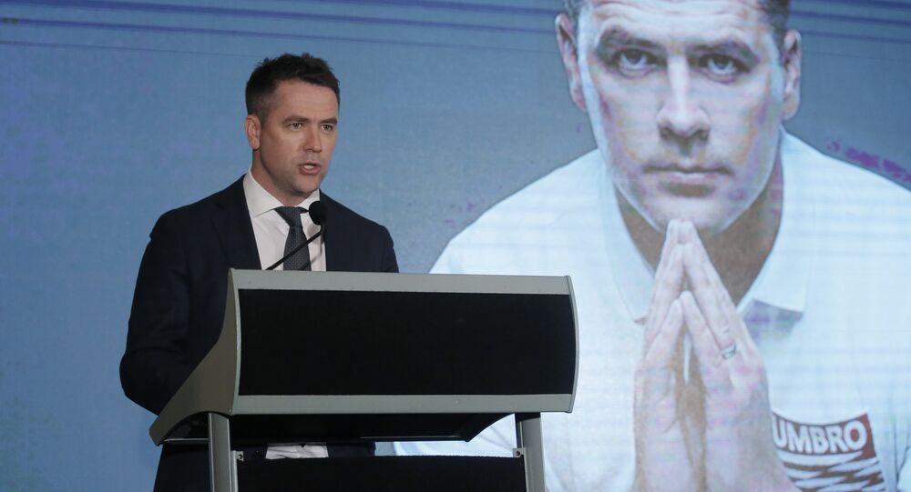 Former British football player Michael Owen speaks during a news conference in Hong Kong. File photo