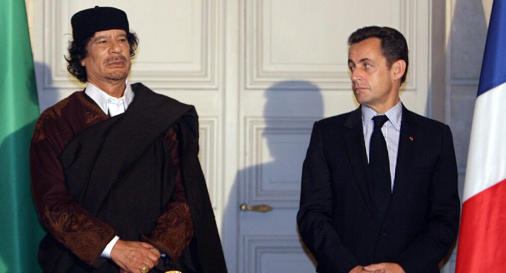Libyan leader Col. Moammar Gadhafi, left, and French President Nicolas Sarkozy, pose during a signing ceremony at the Elysee Palace, Paris. (File)