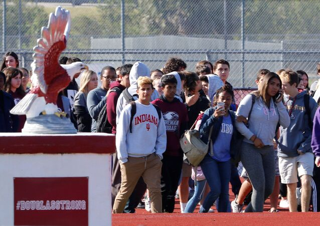 Students walk out of Marjory Stoneman Douglas High School as part of a National School Walkout to honor the 17 students and staff members killed at the school in Parkland, Florida, U.S., March 14, 2018.