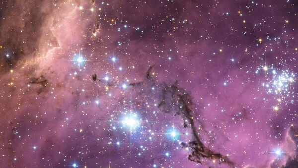NASA image release January 23, 2013 Nearly 200 000 light-years from Earth, the Large Magellanic Cloud, a satellite galaxy of the Milky Way, floats in space, in a long and slow dance around our galaxy.  - Sputnik International
