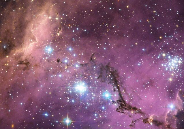 NASA image release 23 January 2013 Nearly 200,000 light-years from Earth, the Large Magellanic Cloud, a satellite galaxy of the Milky Way, floats in space, in a long and slow dance around our galaxy.