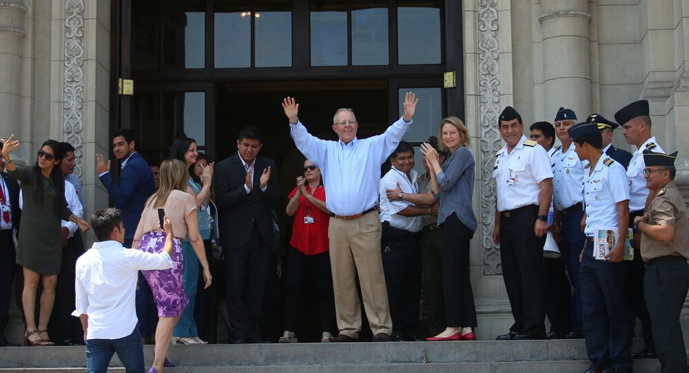 Peru's outgoing President Pedro Pablo Kuczynski greets palace staff members after resignation, at the Government Palace in Lima, Peru