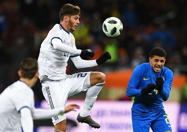 From left: Alexander Yerokhin (Russia) and Taison (Brazil) during a friendly football match between the national teams of Russia and Brazil