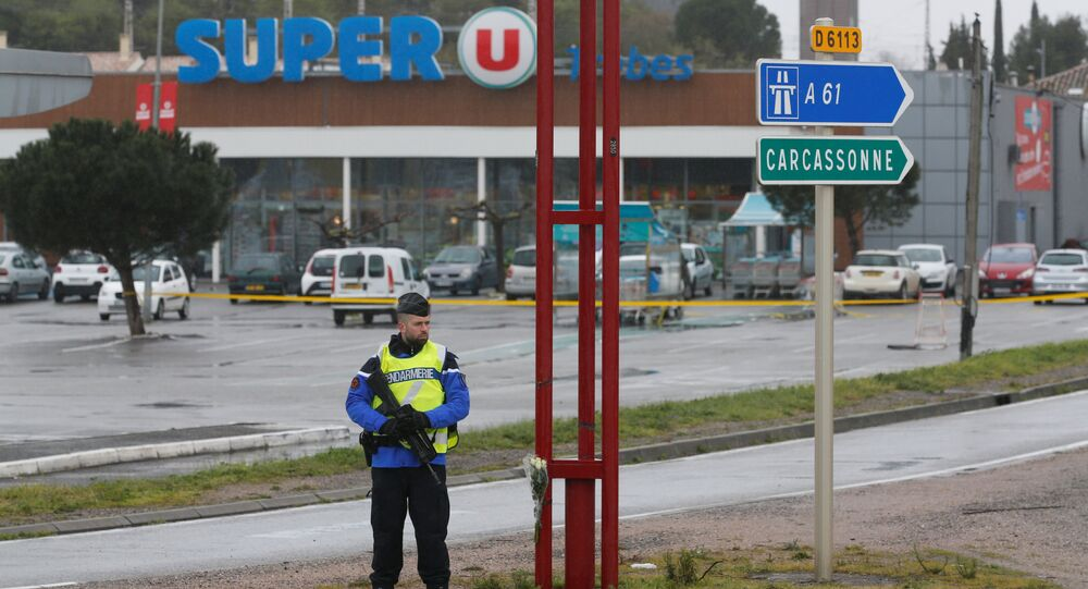 A French gendarme secures the access to a supermarket after a hostage situation in Trebes, France