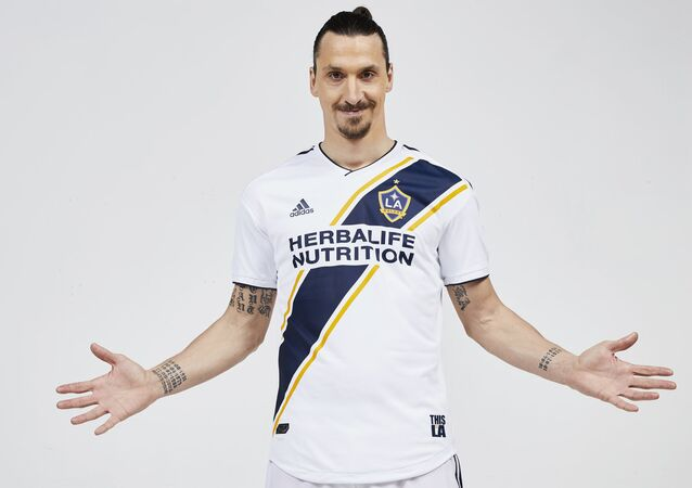 Forward Zlatan Ibrahimovic, of Sweden, poses in the uniform of his new club