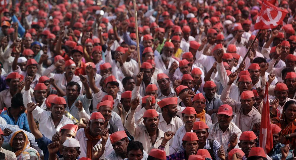 Indian farmers shout slogans during a rally at the end of their six day long march on foot, in Mumbai, India