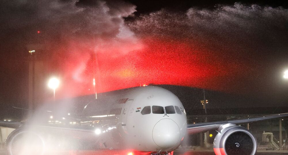 An Air India Boeing 787-8 Dreamliner plane receives a water cannon statue upon its landing at Ben Gurion International Airport in Lod, near Tel Aviv, Israel, March 22, 2018.