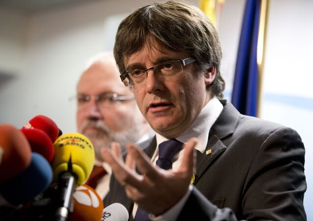 Ousted Catalan leader Carles Puigdemont speaks during a media conference in Brussels on Friday, Dec. 22, 2017