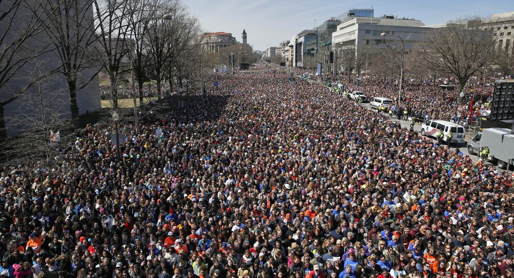 Looking west away from the stage, the crowd fills Pennsylvania Avenue during the March for Our Lives rally in support of gun control, Saturday, March 24, 2018, in Washington.
