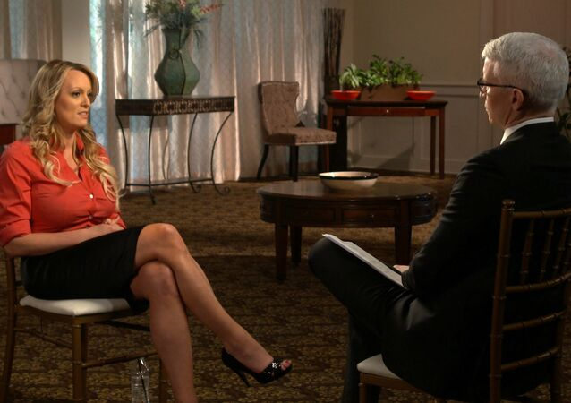 This image released by CBS News shows Stormy Daniels, left, during an interview with Anderson Cooper which will air on Sunday, March 25, 2018, on 60 Minutes.