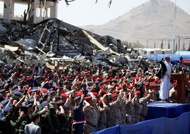 Army officers allied with the Houthis attend a rally at a parade square damaged by air strikes to mark the third anniversary of the Saudi-led intervention in the Yemeni conflict in Sanaa, Yemen March 26, 2018