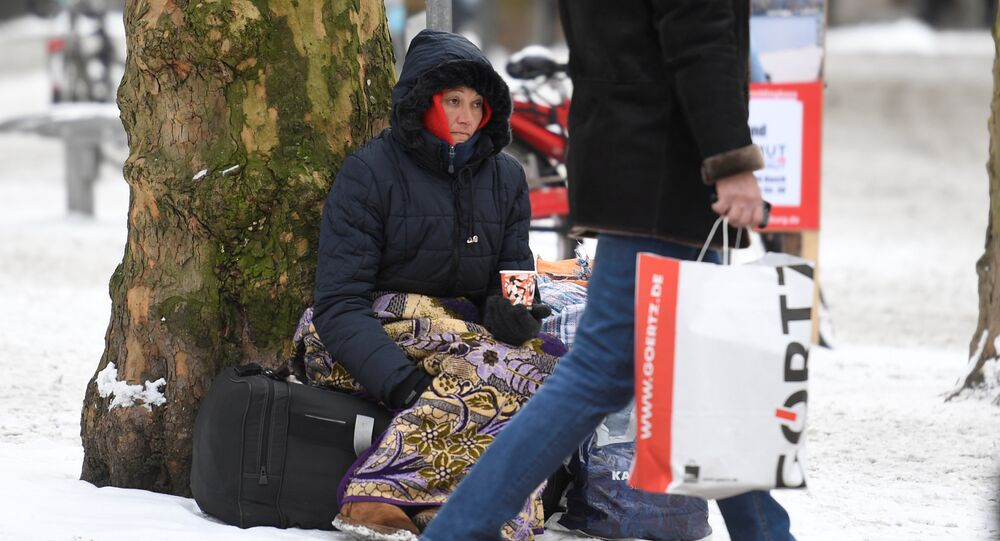 A homeless person begs for money in Hamburg, Germany, February 27, 2018