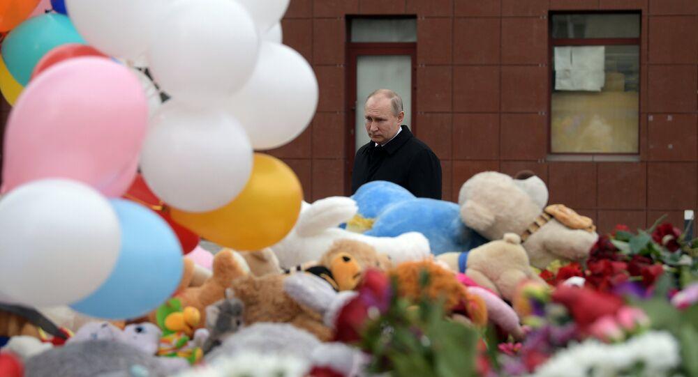 Russian President Vladimir Putin lays flowers at an impromptu memorial near the Zimnyaya Vishnya shopping mall in Kemerovo to honor those killed in the shopping mall fire.