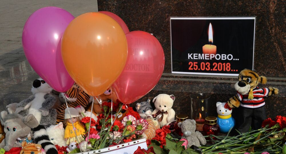 A memorial near the City of Military Glory stele on Vladivostok's central square to honor those killed in the Zimnyaya Vishnya shopping mall fire in Kemerovo