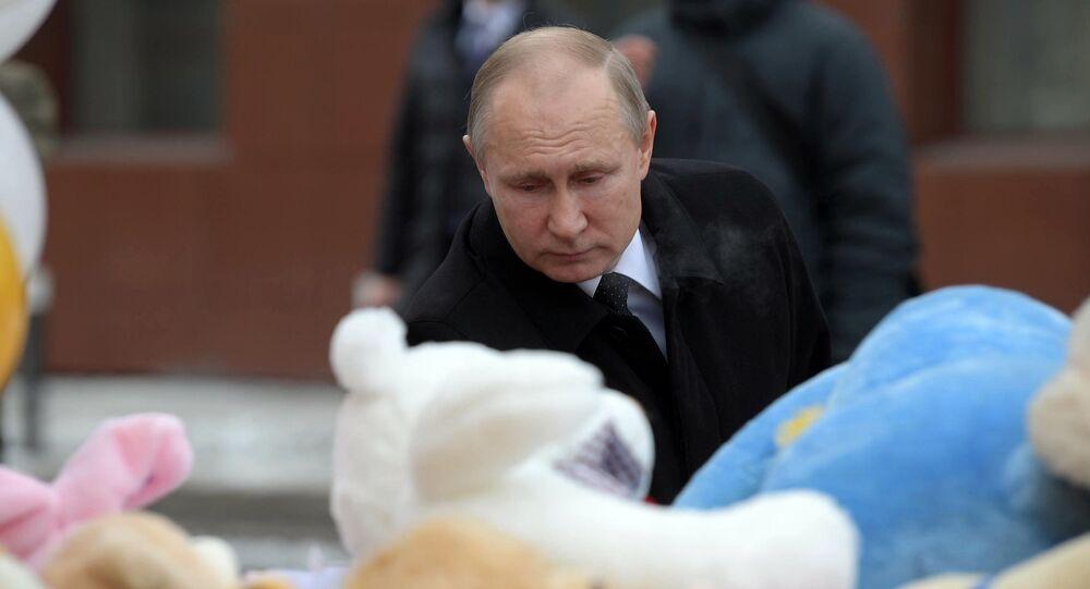Russian President Vladimir Putin lays flowers at an impromptu memorial near the Zimnyaya Vishnya shopping mall in Kemerovo to honor those killed in the shopping mall fire