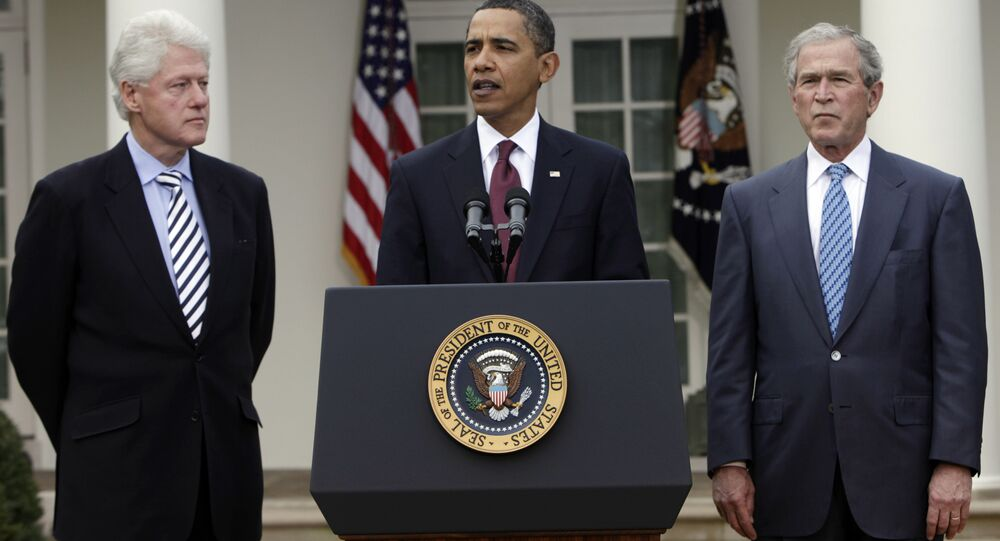 President Barack Obama, center, speaks about Haiti as former presidents Bill Clinton, left, and George W. Bush, right, listen in the Rose Garden at the White House in Washington Saturday, Jan. 16, 2010.