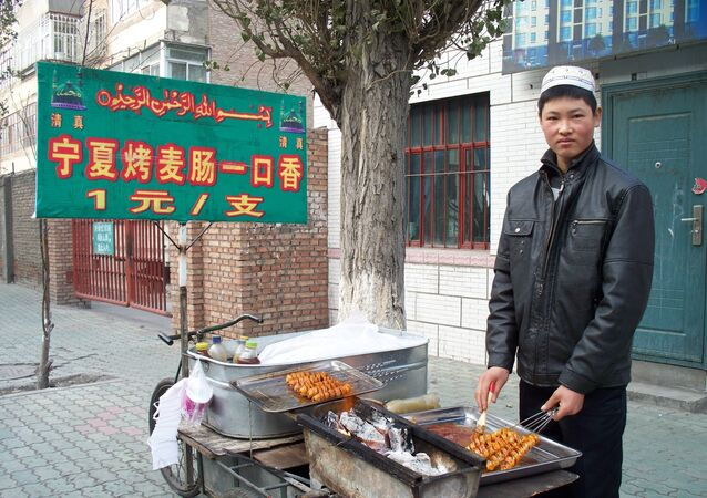 Young Hui muslim man sells kebabs